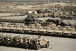 Vehicles and accessory equipment fill a retrograde yard at Camp Warrior, Bagram Airfield, Afghanistan, Oct. 2, 2013, before being shipped from the base 131002-F-YL744-112.jpg