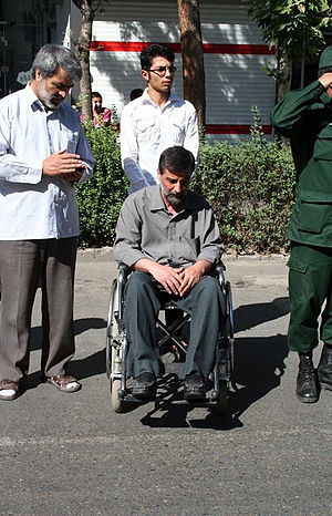 Veteran - An Iranian veteran and war wounded man of Iran–Iraq War on wheelchair in Nishapur, funeral of his comrade