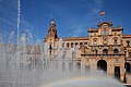 View on the Central Building in The Plaza de España (Parque de María Luisa), through the waters of Central Fountain. Seville, Andalusia, Spain, Southwestern Europe.jpg