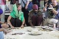 Volunteers at langar kitchen Gurdwara Sis Ganj Delhi.jpg