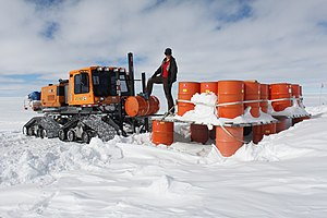 Woman working at the West Antarctic Ice Sheet (WAIS) Divide Field Camp in 2012.
