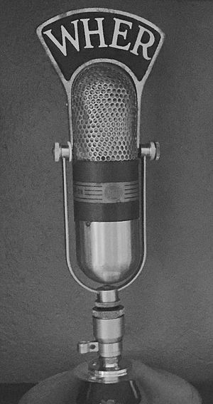 WHER (defunct) - RCA 77 microphone with WHER mic flag.