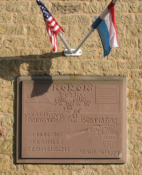 Memorial plaque in Beaufort, Luxembourg, commemorating the liberation by the 5th Arm Div, 9th Arm Div, 9th Inf Div, on the [50th} anniversary of the Libertion, 1994.]