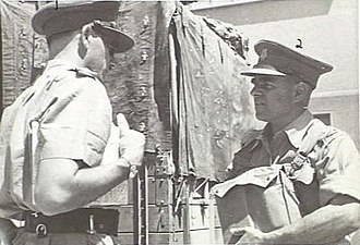 Henry Wells (general) - Colonel Henry Wells (right) converses with a captain during a respirator and gas drill at the 9th Australian Division's Headquarters in Tripoli, Syria.