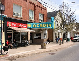 Wolfville - Wolfville streetscape, spring 2006. The view shows the Al Whittle (Acadia) Theatre, a house of movies and live performances now operated by a non-profit cooperative.