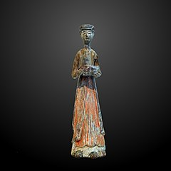 Woman carrying offerings-MA 4666