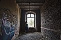 Woman standing by the window inside an abandoned military building in Fort de la Chartreuse, Liege, Belgium (DSCF3352-hdr).jpg
