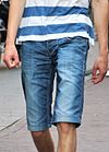 Young man wearing jorts (denim shorts) (cropped).jpg