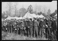 """Newly-arrived replacements at CCC Camp, TVA ^22, near Esco, Tennessee, lined up before their first meal in camp. The... - NARA - 532780.tif"