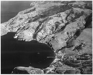 Two Harbors, California - Aerial view of Naval-Coast Guard base at the Isthmus, probably taken in WW2 era. This is the future site of Two Harbors village.