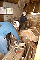 (Hurricane Katrina) New Orleans, LA, 3-13-06 -- Volunteers from the University of Alaska at Fairbanks look for salvageable items in this home that was destroyed from Hurricane Katri - DPLA - 1fe20cad41551318cbc00f3c20b56718.jpg