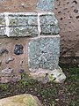 -2020-12-09 A benchmark at the base of the bell tower, Saint Nicholas, Salthouse.JPG