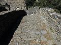 003 Pont del Rossinyol, calçada, al fons l'arc del pas de la Foradada.JPG