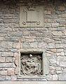 030 Antic Ajuntament de Santpedor, a la plaça Gran, escut i relleu escultòric.JPG