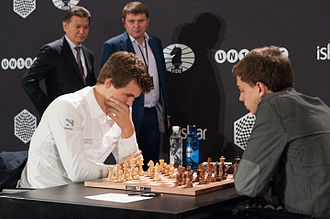 Fast chess - Magnus Carlsen (left) playing GM Dennis Wagner (right) at the 2015 FIDE World Chess Rapid and Blitz Championship in Berlin, at which Carlsen retained the title World Rapid Chess Champion