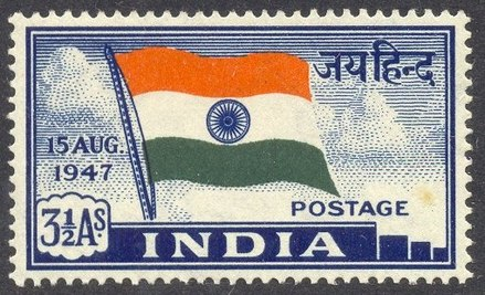 "A postage stamp, featuring a fluttering Indian flag above the word ""INDIA"". At left is ""15 AUG. 1947"" and ""3½ As.""; at right is ""जय हिंन्द"" above ""POSTAGE""."