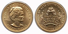 A gold medallion depicting a woman and comedy and tragedy masks