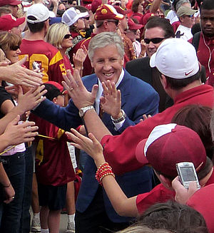"Pete Carroll - Carroll leads his team through the ""Trojan Walk"", a tradition he created at USC in 2001."