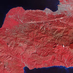 2010 Haiti earthquake - Tiny dots of white against the plant-covered landscape (red in this image) are possible landslides, a common occurrence in mountainous terrain after large earthquakes. The Enriquillo-Plantain Garden fault zone runs along the two linear valleys at the top of the image