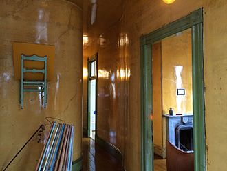 David Ireland (artist) - Upstairs hallway at 500 Capp St., with treated walls and other sculptural installations
