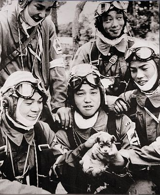 Kamikaze - 26 May 1945. Corporal Yukio Araki, holding a puppy, with four other pilots of the 72nd Shinbu Squadron at Bansei, Kagoshima. Araki died the following day, at the age of 17, in a suicide attack on ships near Okinawa.
