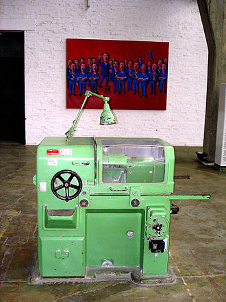 798 Art Zone - One of the old machine tools in front of some contemporary art in Dec 2005