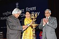 A.P.J. Abdul Kalam lighting the lamp to inaugurate the National Girl Child Day function, in New Delhi. The Minister of State (Independent Charge) for Women and Child Development, Smt. Krishna Tirath is also seen.jpg