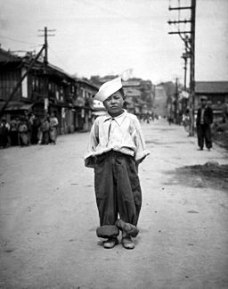A Korean orphan boy adopted by a motor pool battalion at Inchon, Korea and nursed back to health HD-SN-99-03143