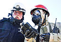 A Soldier, right, from 178th Engineer Company, 1st Maneuver Enhancement Brigade, gives instructions to Joe Bartlett, a Department of Defense civilian with Safety Solutions, during a field training exercise 111206-A-WO769-356.jpg