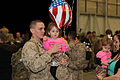 A U.S. Marine with Marine All-Weather Fighter Attack Squadron 224 holds his daughter after a six-month deployment to the Western Pacific in Support of the Unit Deployment Program aboard Marine Corps Air Station 130322-M-EK666-002.jpg