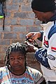 A male hairstylist doing dreadlocks for his client.jpg