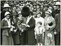 A member of the Band of His Majesty's Grenadier Guards kissing a person in crowd in Martin Place, Sydney after a ceremony at the Cenotaph, 8 November 1934 (8447101008).jpg