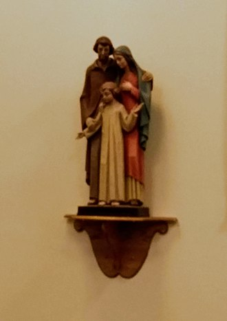 History of Joseph the Carpenter - A statue of Joseph Mary and Jesus in the Holy Family Hospital, Methuen, Massachusetts.