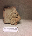 A terracotta tile of Bhismaknagar depicting a person with a hand-cannon.png
