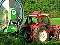A tractor with a huge mobile role of flexible water pipe to spray the fields in Drenthe 2012.jpg