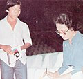 Ade Irawan signing autographs, Festival Film Indonesia (1982), 1983, p55.jpg