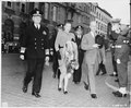 Adm. Harold Stark, and Ambassador to Belgium Charles Sawyer and Mrs. Sawyer, walk to the docks in Antwerp, Belgium to... - NARA - 198786.tif