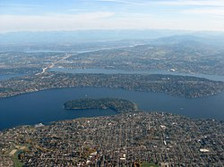 Aerial view of Mercer Island surrounded by Lake Washington (upper center of image, filling the entire frame left to right).