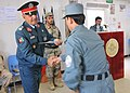 Afghan Brig. Gen. Nasrullah Zarif presents a police NCO graduate a certificate at Kandahar Regional Training Center .jpg