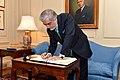Afghan CEO Abdullah Signs Secretary Kerry's Guest Book.jpg