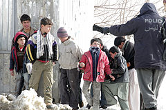 Afghan boys and police in 2010.jpg