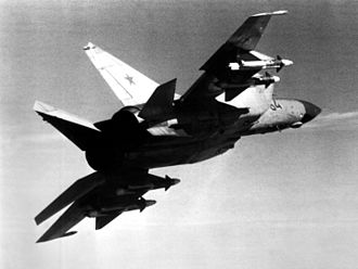 Soviet Air Forces - An air-to-air right underside rear view of a Soviet MiG-25 Foxbat aircraft carrying four AA-6 Acrid missiles