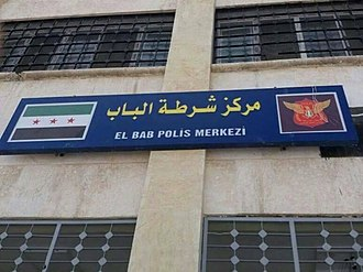 Syrian Turkmen - Bilingual sign (Arabic and Turkish) of Al-Bab police station.