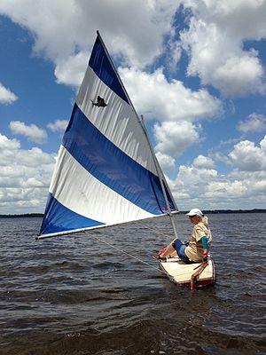 Sailfish (sailboat) - 195? Alcort Super Sailfish named Zsa Zsa under sail in Pensacola Bay Jun 2013.