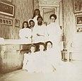 Alexandra Feodorovna with Rasputin, her children and a governess.jpg