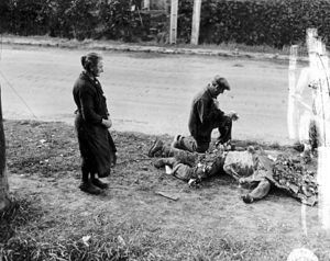 Battle of Carentan - French people laying flowers on the corpses of American soldiers