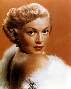 American actress Lana Turner in white fur stole.jpg