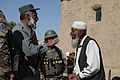 An Afghan Uniform Police (AUP) commander, left, speaks with an elder from Apakhan village in the Kharwar district of Logar province, Afghanistan, Oct. 18, 2011 111018-A-ZI978-085.jpg
