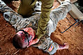 An Israeli soldier, top, treats a U.S. Soldier with simulated wounds during a medical exercise for Austere Challenge 2012 in Beit Ezra, Israel 121022-F-QW942-039.jpg