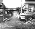 An alley between 1st St and Front St, during regrade project, Port Angeles, 1914 (CURTIS 119).jpeg